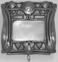 Glasgow style pewter brooch modelled on the Honesty Mirror, maybe by Frances Macdonald McNair, maybe not