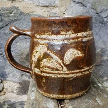 A tankard made at Morar Pottery with Alex's personal seal and the Morar Pottery MP seal at the base of the handle